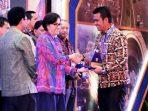 Bupati Bintan Apri Sujadi Saat Menerima Penghargaan WTP Tingkat Nasional Dari Menteri Keuangan RI