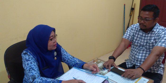 Kasat Reskrim Polres Tanjungpinang, AKP Efendri Ali saat menjumpai Kepsek SMP Negeri 7 Tanjungpinang Timur