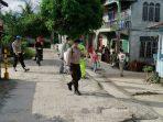 MR, Satgas dan Polisi Disinfektan rumah warga di Singkep